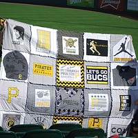 Steve and Nancy Thomas with her Pirates quilt at spring training in Bradenton, on March 13