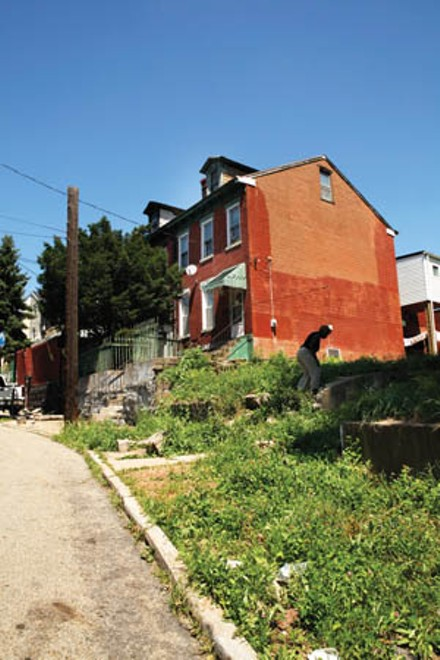 In 2009 the city promised to fix up crumbling Lombard Street in the Hill District. Residents say little, if anything, was done. - PHOTO BY HEATHER MULL