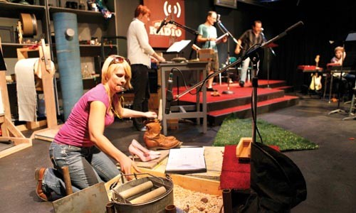 In rehearsal for September's Midnight Radio, Foley artist Dixon works a whistle, old shoes and gravel. - HEATHER MULL