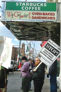 Industrial Workers of the World member Jonah McCallister pickets the Starbucks in Bloomfield with IWW organizer Kevin Farkas, as the IWW national organizing campaign continues here. - PHOTO BY CHARLIE DEITCH