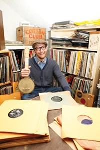 Is that a banjolele? Elliott Sussman shows off his stash. - PHOTO BY HEATHER MULL
