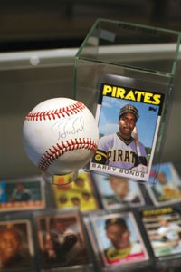Items like Barry Bonds' 1986 Topps rookie card and a baseball signed by the soon-to-be homerun king are easy to find at stores like Smithfield Street's Sports World Specialties. - PHOTO BY HEATHER MULL