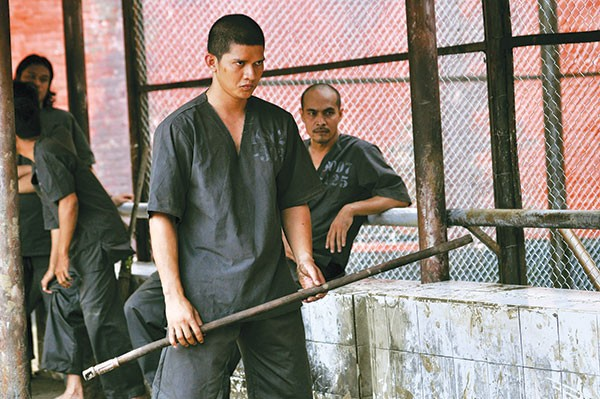 It's about to get real: Rama (Iko Uwais) and a broom handle