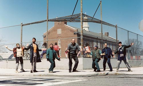 James Gandolfini (center) leads a street-corner serenade.
