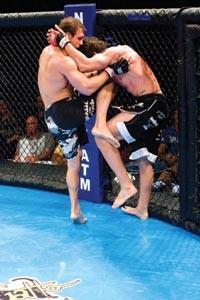 Jeanette's James Brasco knees his opponent Matt Brown of Columbus, Ohio. - RENEE ROSENSTEEL