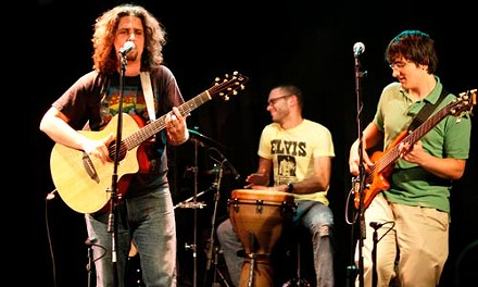 Joel Lindsey (left) helped re-launch AcoustiCafe in 2007 and now hosts Tip Jar, a satellite event. He heads up the band Boulevard of the Allies, which includes percussionist Chris Massa and bassist Jim Kurasch, and gets many in the audience dancing or singing along. - HEATHER MULL
