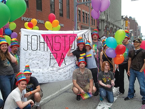 John DeBartola (at right, kneeling before banner) at Pittsburgh Pride 2011