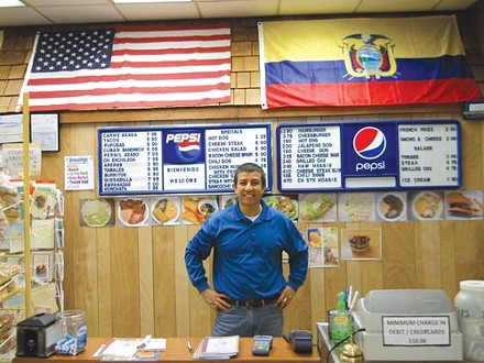 Jorge Flores works to make his community as diverse as the flags on the wall of his restaurant, La Colombiana.