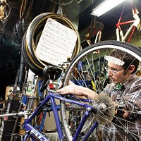 Josh Lane fixes his own bike at Kraynick's Bike Shop.