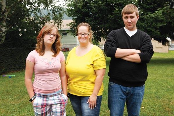 Josh Miller's ex-wife, Brandi Mangus (center), with their two children, Caitlyn and Josh, Jr. Miller - PHOTO BY HEATHER MULL