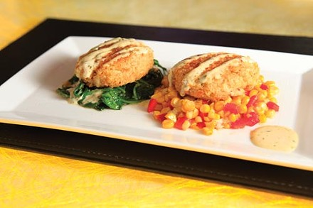 Jumbo lump crab cakes over sauted spinach, and corn and red peppers - PHOTO BY HEATHER MULL