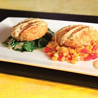 Jumbo lump crab cakes over sauted spinach, and corn and red peppers