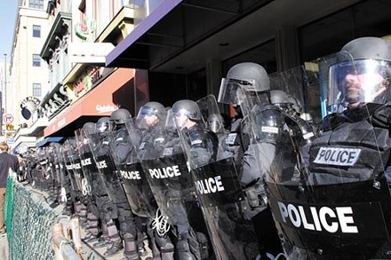 June 2006: Police in riot gear await yet another Oakland protest. - PHOTO BY RENEE ROSENSTEEL