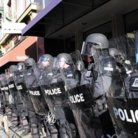 June 2006: Police in riot gear await yet another Oakland protest.