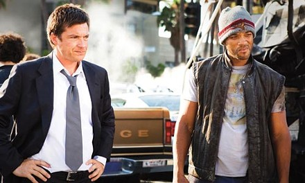 Just who needs saving, anyhow? Jason Bateman and Will Smith.