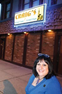 Kail-Smith poses in front of Craig's, a bar in Sheraden. - HEATHER MULL