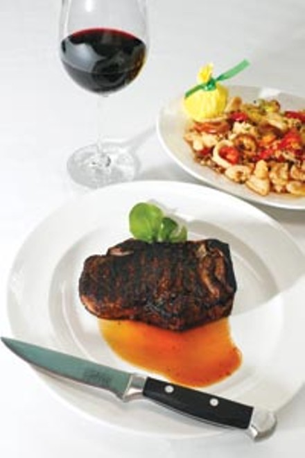 Kansas City sirloin steak with pan-fried calamari and hot cherry peppers - HEATHER MULL