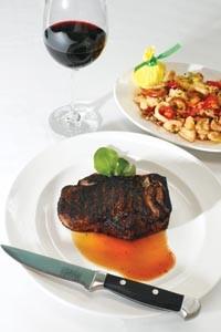 Kansas City sirloin steak with pan-fried calamari and hot cherry peppers - HEATHER MULL