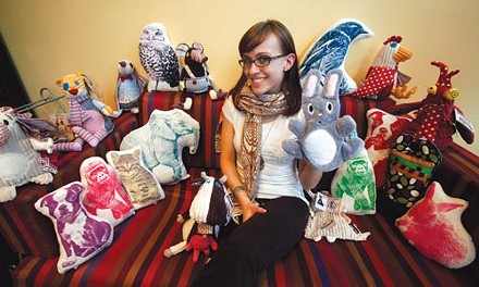 Kate Thiel, part-owner of Divertido, poses with stuffed creatures that you need. - HEATHER MULL