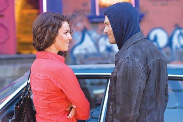 Katherine Heigl (left) investigates a hoodie.