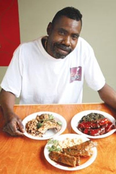 Kevin Cole, owner of Mr. Willie's BBQ in Squirrel Hill, with jerk chicken, beef ribs in barbeque sauce and pork ribs in mustard sauce. - HEATHER MULL