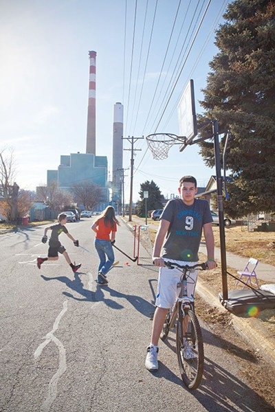 Kids play on Garfield Street in Springdale on the first spring-like day in March. - PHOTO BY HEATHER MULL
