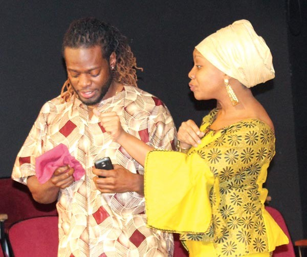 """Larry Scott and Candace Walker in Kim El's """"An Ubuntu Holiday,"""" part of the Theatre Festival in Black & White."""
