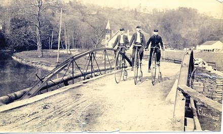 Lenz, at right, and two fellow Allegheny Cyclers cross a bridge in Glenshaw.