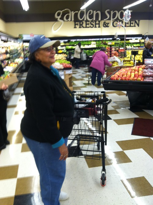 Lifelong Hill District resident Eunice Bradberry takes her first trip through the new grocery store.