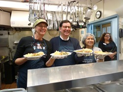 Mayor Peduto stopped by to talk with volunteers and media about poverty in Pittsburgh. - PHOTO BY ASHLEY MURRAY