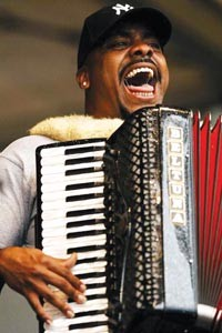 "Lil' Brian and the Zydeco Travelers will perform at ""Mardi Gras Night."""