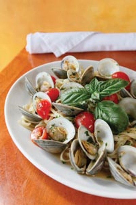 Linguine alle Vongole with fresh Manilla clams, cherry tomatoes and garlic in a white-wine sauce - HEATHER MULL