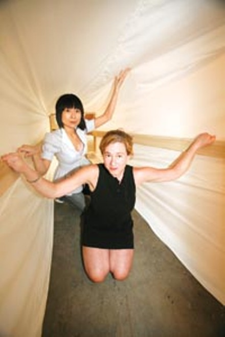 Linkin' tunnel: Astria Suparak (left) and Julia Christensen get inside Christensen's Your Town, Inc., at Miller Gallery.