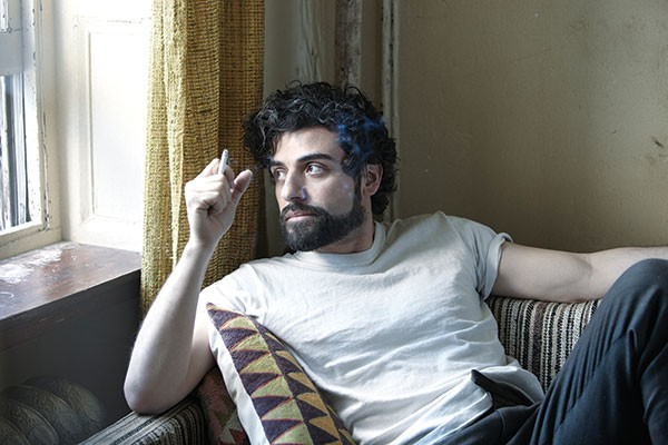Llewyn Davis (Oscar Isaac) rests between songs.
