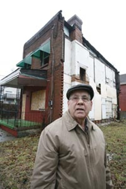 Long-time neighbor Saverio Strati tours some of Hazelwood's least attractive real estate. - HEATHER MULL