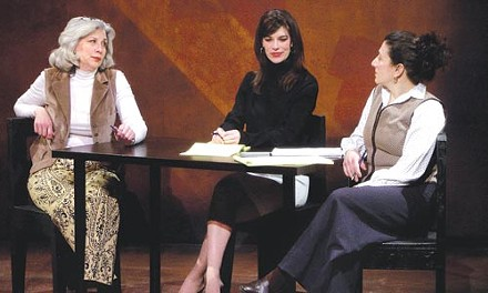 Lori Maxwell (left), Amy Marsalis (center) and Judy Kaplan taste Asparagus at Open Stage Theater.