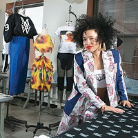 Makayla Wray and some of the clothing she's designed at the sewing lab in the Art Institute of Pittsburgh, where she is a student.