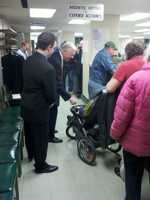 Mayoral candidate Jack Wagner high fives a baby before filing his election petitions Tuesday