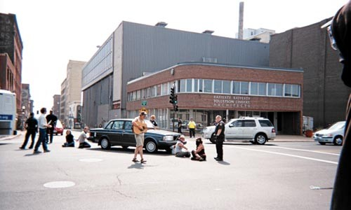 Members of POG chained themselves to a car in downtown St. Paul. - PHOTO COURTESY MARIE SKOCZYLAS