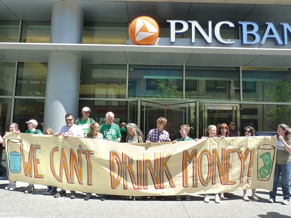 Members of the Earth Quaker Action Team protest PNC in May 2012