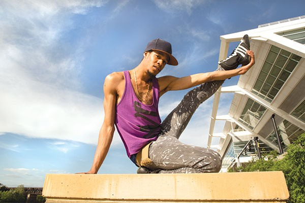Michael Brookins, a Project Silk staff member, poses in front of the convention center.