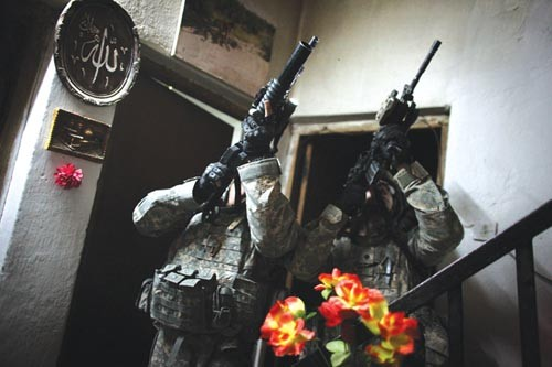 "Michael Kamber's ""Soldiers on patrol in Iraq"" (2008), a still image from the video Military Censorship (2010) - COURTESY OF THE ARTIST AND WITH PERMISSION FROM MICHAEL SHAW, BAGNEWSNOTES"