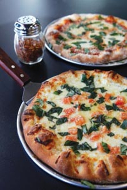 Mio Bianco pizza, with fresh tomatoes and basil - HEATHER MULL