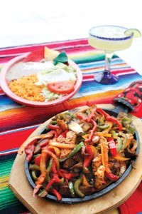 Mixed fajita with chicken and beef, refried beans, rice, and a margarita - HEATHER MULL
