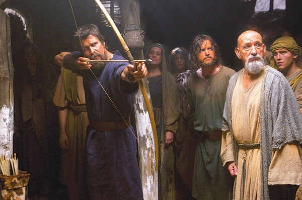 Moses, Christian Bale, with fellow warriors, Aaron Paul and Ben Kingsley