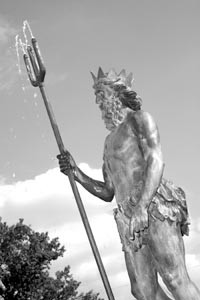 Neptune, situated by the Highland - Park swimming pool, appears very - pleased to have his trident back.