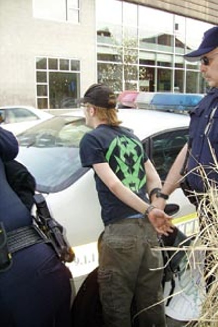 Noah Willumsen, right, is handcuffed following the counter-recruitment protest in April (Photo courtesy of the Pittsburgh Organizing Group).