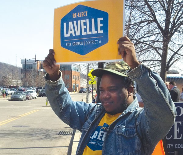 North Side resident Corey Carrington campaigns for incumbent Daniel Lavelle Sunday afternoon .