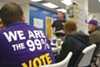 Obama campaign volunteers, including a group from SEIU, listen to neighborhood team leader Matt Phillips give canvassing instructions Oct. 6.
