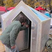 Occupier Austin Zahar shows off a yurt
